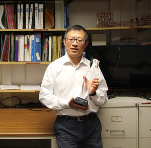 Mingzhong Wu holds the Professor Laureate award.