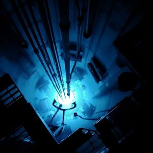 A nuclear reaction illuminates the inside of a machine.