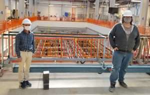Post-doctoral research Biswaranjan (Bishu) Behera and graduate student Tyler Boone in the ICARUS detector hall at Fermi National Accelerator Laboratory (October 2020).